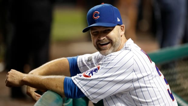 David Ross looks on from the Chicago Cubs dugout during the 2016 World Series.