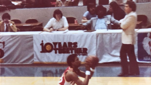 As John Drew of the Hawks sets to shoot a free throw during a game payed Nov. 28, 1978 at the Richfield Coliseum, Hawks coach Mike Fratello looks on. I suspect that is Plain Dealer columnist Terry Pluto (white shirt, seated), at the press table.