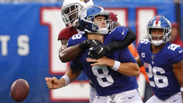 Oct 20, 2019; East Rutherford, NJ, USA; New York Giants quarterback Daniel Jones (8) fumbles the ball after a hit by Arizona Cardinals cornerback Patrick Peterson (21) during the second half at MetLife Stadium.