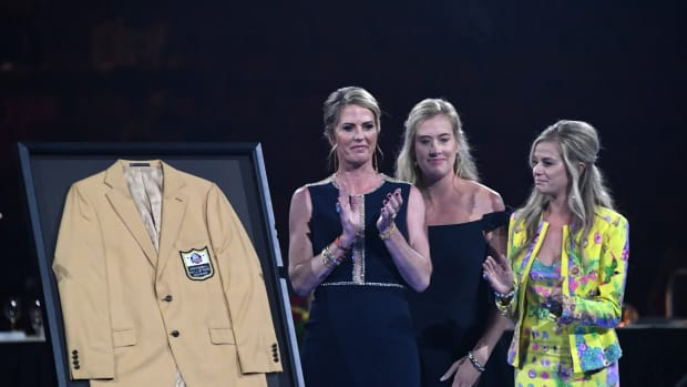 The family of the late Pat Bowlen pose with his gold jacket during the Enshrinees Gold Jacket dinner at Memorial Civic Center and Cultural Center. From left: wife Beth Bowlen and daughters Brittany Bowlen and Annabel Bowlen.