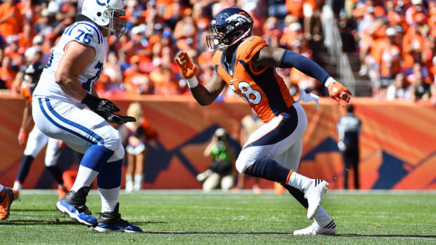 Denver Broncos outside linebacker Von Miller (58) pass rushes on Indianapolis Colts offensive tackle Joe Reitz (76) in the first half at Sports Authority Field at Mile High.
