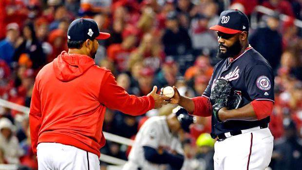 Oct 26, 2019; Washington, DC, USA; Washington Nationals manager Dave Martinez pulls relief pitcher Fernando Rodney (56) from the game during the seventh inning against the Houston Astros in game four of the 2019 World Series at Nationals Park. Mandatory Credit:  Brad Mills-USA TODAY Sports
