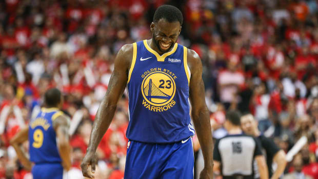 Warriors' Draymond Green winces on the court