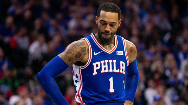 Sixers' Mike Scott reacts on the court