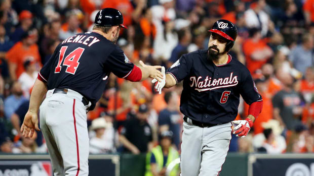 Oct 29, 2019; Houston, TX, USA; Washington Nationals third baseman Anthony Rendon (6) celebrates with third base coach Bob Henley (14) after hitting a two-run home run against the Houston Astros during the seventh inning in game six of the 2019 World Series at Minute Maid Park. Mandatory Credit: Troy Taormina-USA TODAY Sports