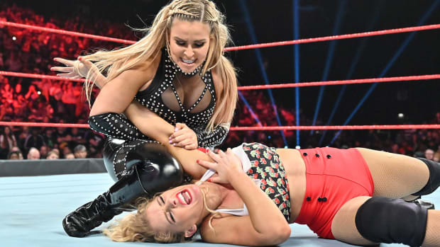 WWE's Natalya and Lacey Evans wrestle in the ring
