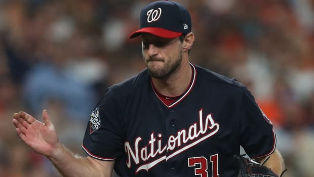 Max Scherzer celebrates during Game 1 of the World Series against the Houston Astros.