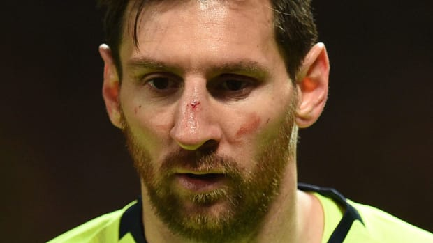messi-face-smalling-barcelona.jpg