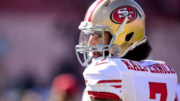 Colin Kaepernick, Eric Reid settle grievances against NFL-IMAGE