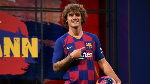 fc-barcelona-unveil-new-player-antoine-griezmann-5d347521d059d60619000001.jpg