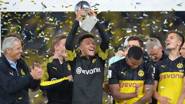 jadon_sancho_lifts_trophy_as_dortmund_wins_supercup.jpg