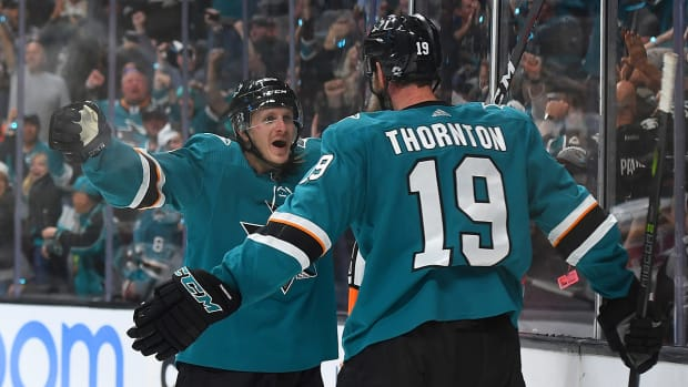 thornton_and_sorensen_hug_it_out_as_sharks_take_game_1.jpg