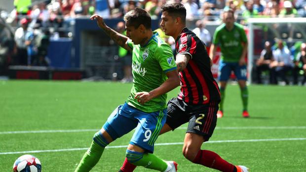 raul_rudidiaz_holds_off_atlanta_united_defender.jpg