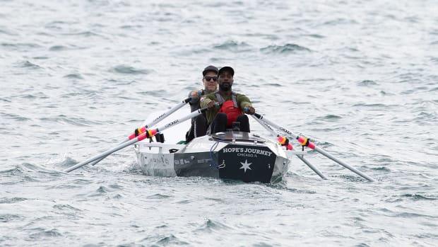 peanut-tillman-rowing-lake-michigan.jpg