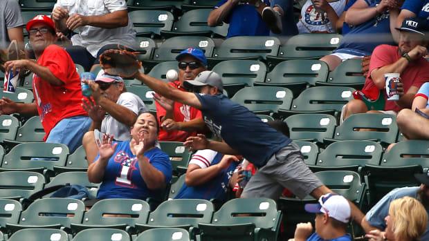 fan-hit-rangers-game-texas.jpg