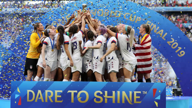 uswnt-huddle-womens-world-cup-trophy.jpg