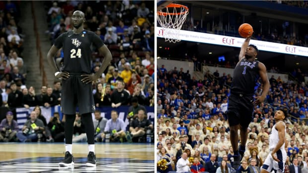 tacko-fall-zion-williamson-dunk-march-madness.jpg