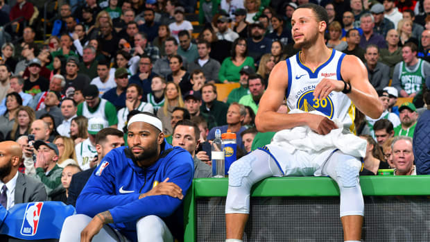 boogie_sitting_with_steph_at_scorers_table.jpg