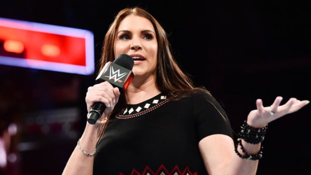 WWE's Stephanie McMahon holds the mic in the ring