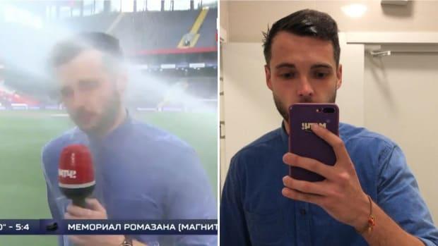 tuesday-hot-clicks-russia-soccer-reporter-sprinkler-video.jpg