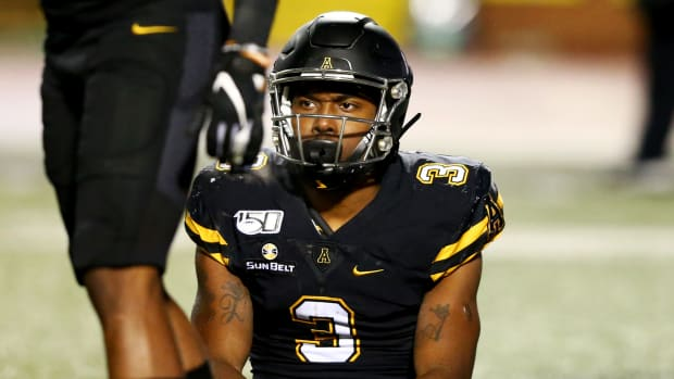 Oct 31, 2019; Boone, NC, USA; Appalachian State Mountaineers running back Darrynton Evans (3) sits on the field after being tackled for a loss during the third quarter against the Georgia Southern Eagles at Kidd Brewer Stadium. Mandatory Credit: Jeremy Brevard-USA TODAY Sports