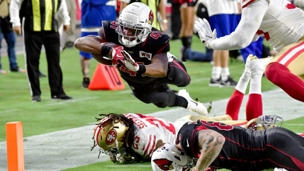 Oct 31, 2019; Glendale, AZ, USA; Arizona Cardinals running back Kenyan Drake (41) dives over San Francisco 49ers cornerback Richard Sherman (25) to score a touchdown  in the first quarter at State Farm Stadium. Mandatory Credit: Matt Kartozian-USA TODAY Sports