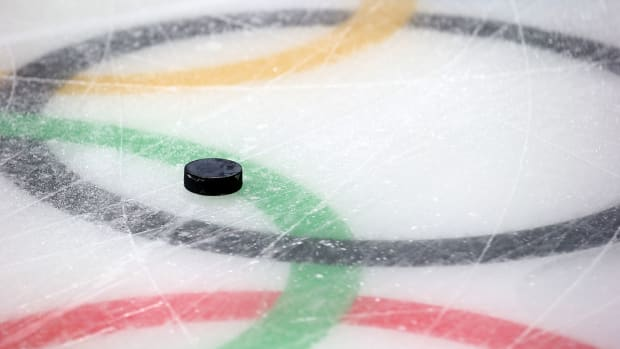 olympic-rings-hockey-puck-1300.jpg