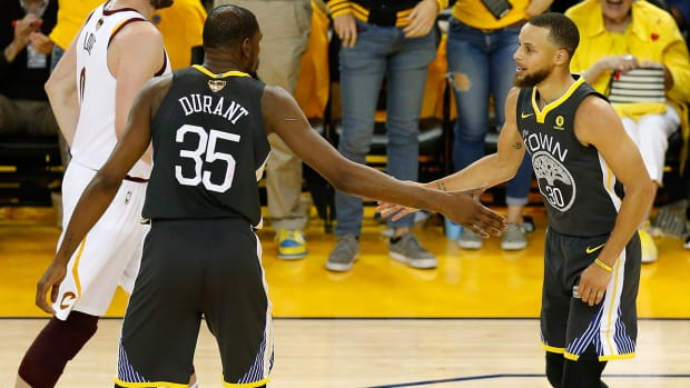 steph_and_kd_dap_up_after_game_2_win.jpg