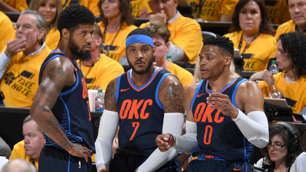 russ_pg_and_melo_breaking_up.jpg