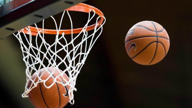 man-pretends-high-school-basketball.jpg