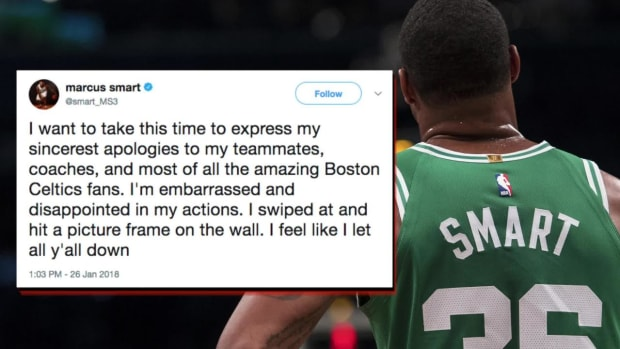 Marcus Smart Hurt His Hand By Hitting a Picture Frame on a Wall - IMAGE