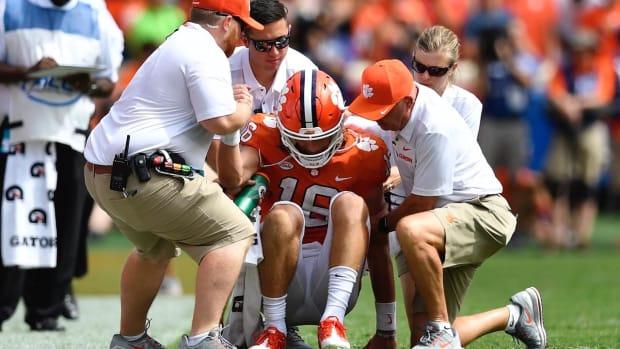 Clemson Quarterback Trevor Lawrence Exits Game vs. Syracuse After Taking Hit to Helmet - IMAGE