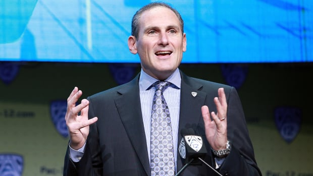 larry-scott-interview-pac-12-media-days-podium.jpg