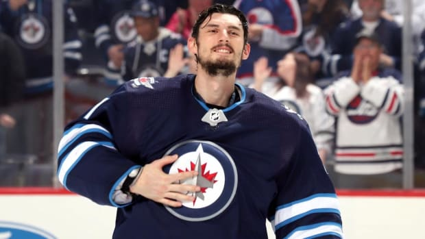 Goalie Connor Hellebuyck Signs Six-Year Deal to Stay With Jets - IMAGE