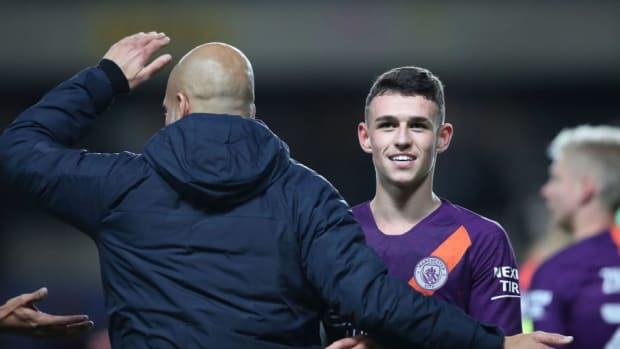 pep-guardiola-with-youngster-phil-foden-5bab4df17b50374a6a000003.jpg