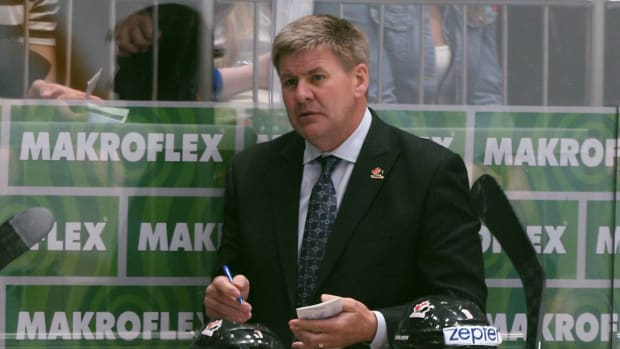 bill-peters-flames-hire-coach-1300.jpg
