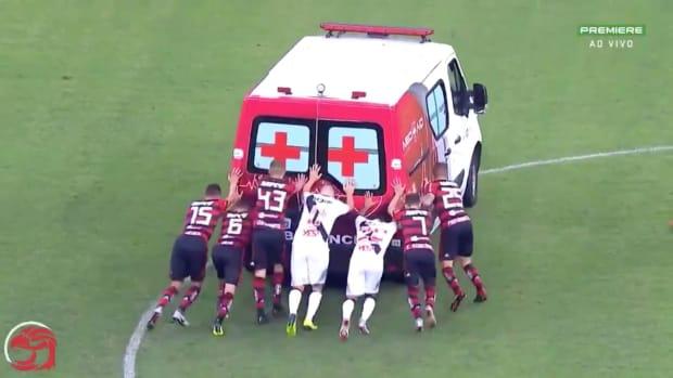 soccer-players-push-ambulance-off-pitch.jpg