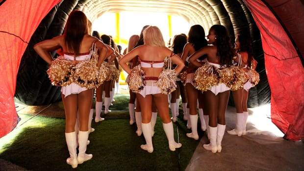 redskins-cheerleaders-2013-costa-rica-topless-photoshoot-discomfort.jpg