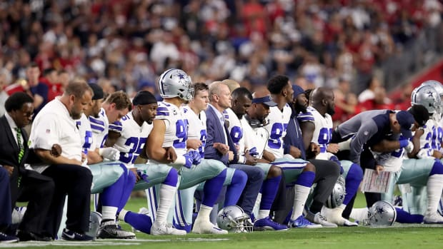 nfl-players-react-protest-national-anthem-policy.jpg
