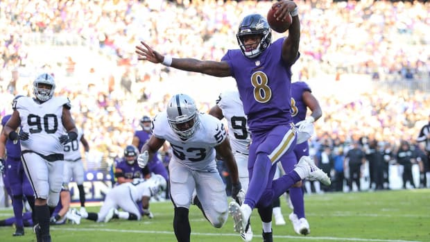 Michael Vick Tells Lamar Jackson to 'Proceed With Caution'