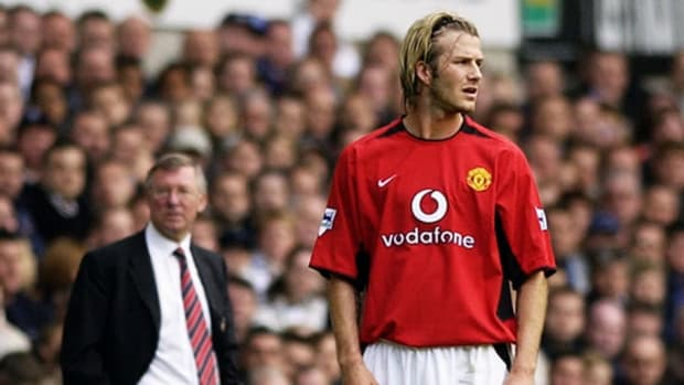 david-beckham-of-manchester-united-and-his-manager-sir-alex-ferguson-look-in-different-directions-5b86c7fe641384a698000001.jpg