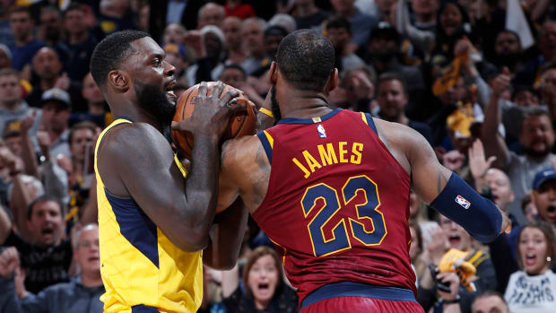 lebron_and_lance_fight_over_the_ball.jpg