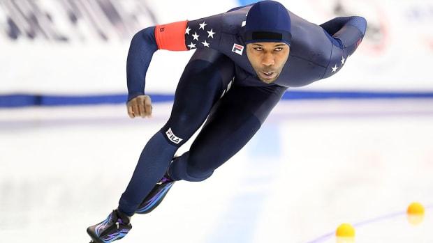 shani-davis-speed-skate-flag-bearer.jpg