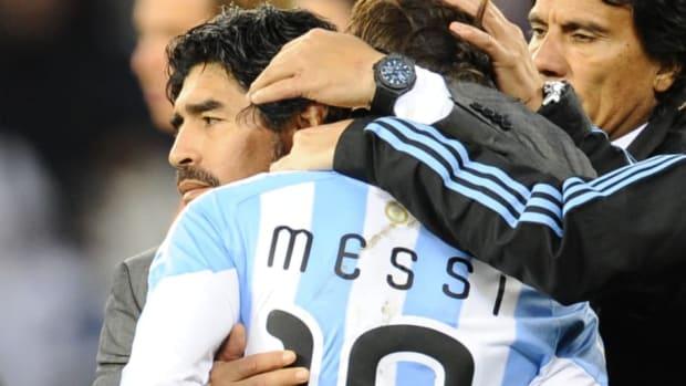 argentina-s-coach-diego-maradona-hugs-ar-5bb2386414db2f98ea000001.jpg
