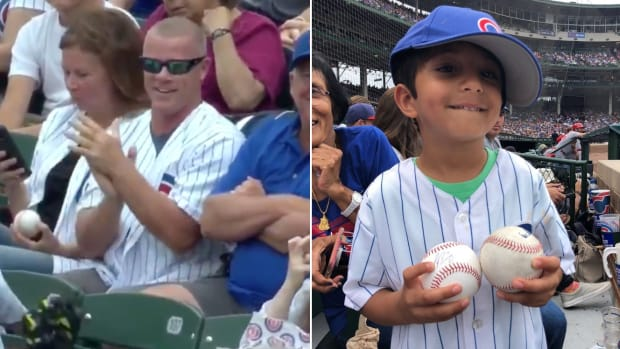 cubs-fans-steals-ball-kid-javier-baez-autograph-video.jpg