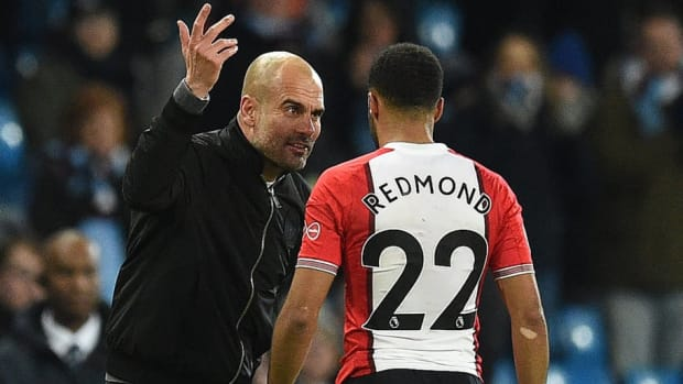 pep-guardiola-and-nathan-redmond-5af57ed3347a02a727000001.jpg