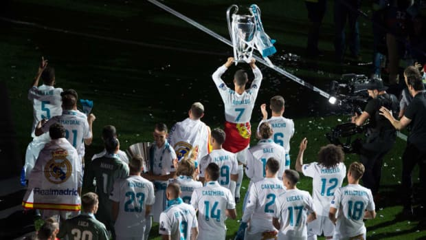 real-madrid-celebrate-after-victory-in-the-champions-league-final-against-liverpool-5b0fb04973f36c38e7000005.jpg