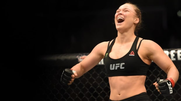 Ronda Rousey Makes WWE Debut After Women's Royal Rumble, Signs Full-Time Contract - IMAGE