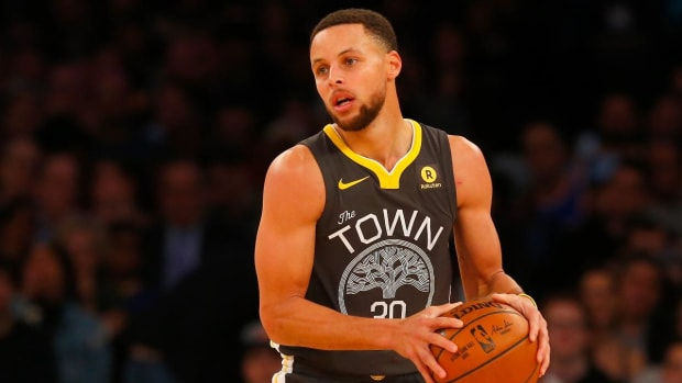 Give and Go: How Will Steph Curry's Injury Impact the Warriors' Playoff Run? - IMAGE