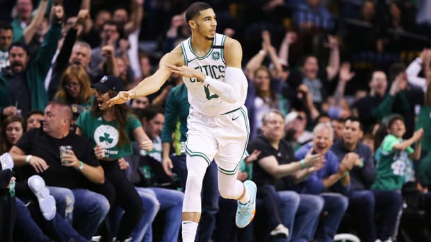 jayson_tatum_loads_up_the_3_cannon.jpg